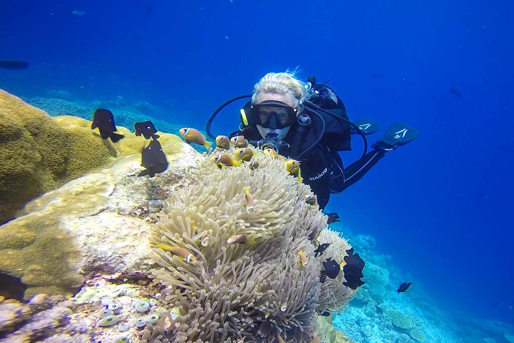 Stephanie diving in Maldives with clown fish.