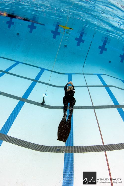 Margo swimming in San Diego freediving pool.