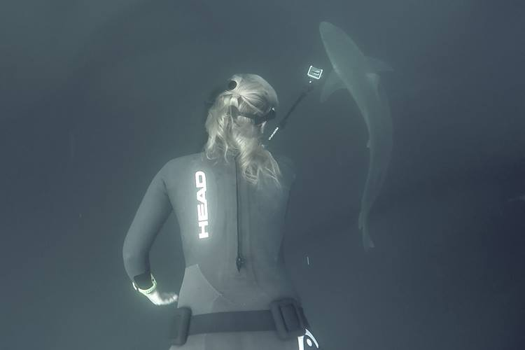 Stephanie filming in head wetsuit.