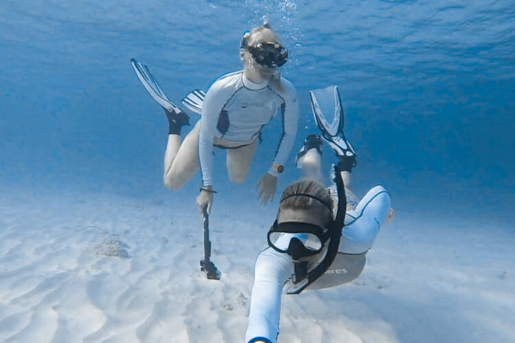 Snorkeling along the house reef .